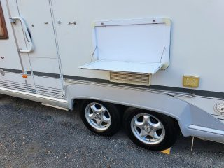Geist XKlusiv 660 Caravan for Sale - outdoor table and wheels